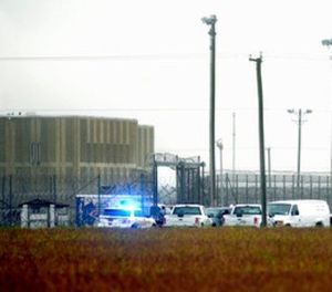 In this Oct. 12, 2017, file photo, police vehicles are seen outside Pasquotank Correctional Institution in Elizabeth City, N.C. (Thomas J. Turney /The Daily Advance via AP, File)