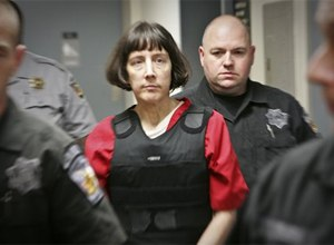 1b660037e16 Amy Bishop is escorted by sheriff's deputies at the Madison County  Courthouse in Hunstville, Ala