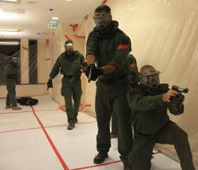Above, Fremont (Calif.) SWAT respond to a workplace violence / active shooter scenario on the 44th floor of the Pyramid Center (nee, Transamerica Pyramid).  For added pucker factor, the team approached the floor via four-story rappel down an air shaft.  (PoliceOne Image)