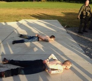 This photo provided by the Tennessee Bureau of Investigation shows the arrest of the two Georgia fugitives Donnie Rowe, top, and Ricky Dubose, bottom, in Christiana, Tenn., Thursday, June 15, 2017. (Photo/Tennessee Bureau of Investigation via AP)