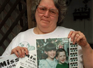 Glenda Whitson holds a picture of her granddaughter, Amber, 9, along with flyers advertising for the whereabouts of the missing child, Monday, Jan. 15, 1996, in Arlington, Texas. Amber was abducted two blocks from Whitson's home while riding her bicycle on Saturday. (AP Photo/Bill Janscha)