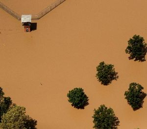 The guard tower at a Texas State prison unit is submerged by water from the flooded Brazos River in the aftermath of Hurricane Harvey Friday, Sept. 1, 2017, in Rosharon, Texas (AP Photo/Charlie Riedel)