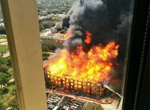 Houston fire officials say no injuries have been reported as a result of the dramatic blaze first reported about 12:30 p.m. Tuesday. (AP Photo/ Christopher Laski)