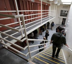 In this Aug. 17, 2011 file photo, reporters inspect one of the two-tiered cell pods in the Security Housing Unit at the Pelican Bay State Prison near Crescent City, Calif. (AP Photo/Rich Pedroncelli)