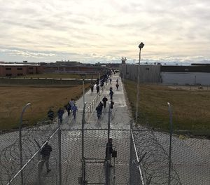 In this Jan. 30, 2018, photo inmates walk across the grounds of the Idaho State Correctional Institution in Kuna, Idaho. (AP Photo/Rebecca Boone)