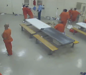 The security video from the Elgin Middlesex Detention Centre shows inmate Anthony George place his cellmate Adam Kargus in a chokehold at least four times, often in full view of other inmates. (Ontario Superior Court of Justice)