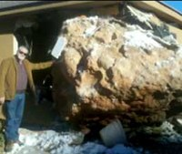 Truck-size boulder smashes into house, badly injures woman