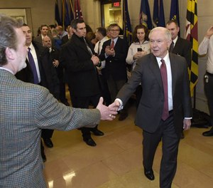 In this Feb. 9, 2017 file-pool photo, Attorney General Jeff Sessions is greeted by employees as he arrives at the Justice Department in Washington. (AP Photo/Susan Walsh, File)