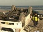 Injured driver kicks EMT after crash on beach