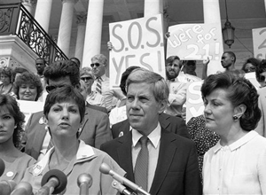Candy Lightner, left, founder and president of (MADD) Mother Against Drunk Drivers, faces reporters, on June 14, 1983, at Capitol Hill, Washington. Lightner is joined by Sen. Richard Lugar, R-Ind., and Transportation Secretary Elizabeth Dole. The three favor a national drinking age of 21. (AP Photo/J. Scott Applewhite)