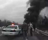 Video: Officer hurt trying to save man from burning car