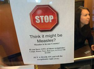 A sign warns of the dangers of measles in the reception area of a pediatrician's office in Scottsdale, Ariz., Saturday, Feb. 7, 2015. Health officials in the state continue to see cases of the disease which had been eradicated in the U.S. (AP Photo/Tom Stathis)
