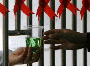 A drug addict receives a cup of methadone at a hospital in Nanjing, China. (Photo Sean Yong/Reuters)