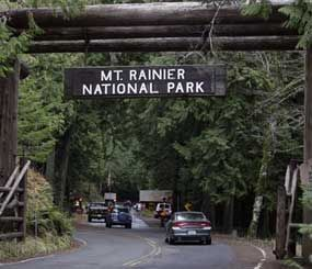 The west entrance to Mount Rainier National Park is shown in this Jan. 1, 2012 file photo taken in Washington State. A Mount Rainier ranger slid more than 3,000 feet to his death Thursday June 21, 2012 as he helped in efforts to rescue four injured climbers who fell on a glacier, a National Park Service spokesman said.  (AP Image)