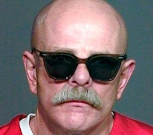 "This undated prison inmate photo shows Aryan Brotherhood gang leader Barry ""The Baron"" Mills. (Courtesy of The Orange County Register via AP)"
