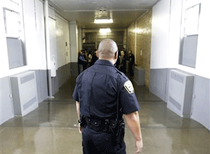 A Department of Corrections Officer walks to the Wasatch A-East block during a media tour Thursday, Feb. 26, 2015, at the Utah State Correctional Facility in Draper, Utah. (AP Photo/Rick Bowmer, Pool)