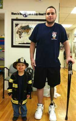 Photos Ralph Lettieri Lettieri stands with a cane for the first time with his son.
