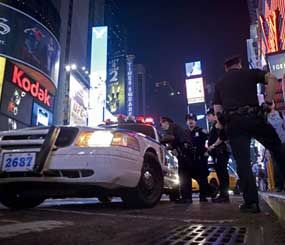 """Police found an """"amateurish"""" but potentially powerful bomb that apparently began to detonate but did not explode in a smoking sport utility vehicle in Times Square, authorities said Sunday. (AP Photo)"""