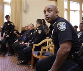 Former Oakland Police Chief Anthony Batts moves out of his chair during a news conference with Oakland Mayor Jean Quan and new Oakland interim police chief Howard Jordan at Oakland City Hall in Oakland, Calif., Thursday, Oct. 13, 2011. Batts resigned on Tuesday and was replaced by Jordan. (AP Image)