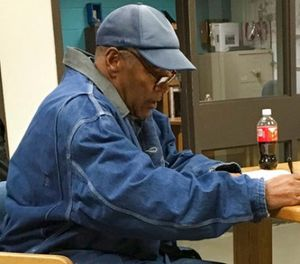 Former football legend O.J. Simpson signs documents at the Lovelock Correctional Center, Saturday, Sept. 30, 2017, in Lovelock, Nev. (Brooke Keast/Nevada Department of Corrections via AP)