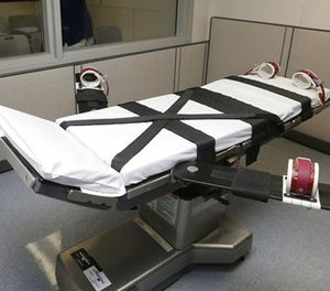 This Oct. 9, 2014 file photo shows the gurney in the the execution chamber at the Oklahoma State Penitentiary in McAlester, Okla. (AP Photo/Sue Ogrocki, File)