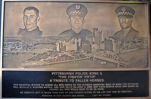 A plaque honoring the three officers is at the Zone 5 police station.