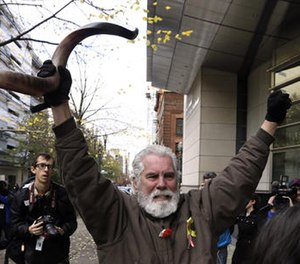 Brand Thornton celebrates after hearing a verdict outside federal court in Portland, Ore., Thursday, Oct. 27, 2016. A jury exonerated brothers Ammon and Ryan Bundy and five others of conspiring to impede federal workers from their jobs at the Malheur National Wildlife Refuge. (AP Photo/Don Ryan)