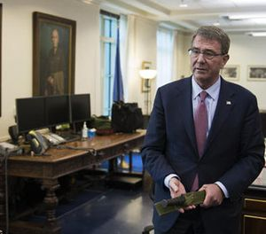 Secretary of Defense Ash Carter holds a Marine Corps Ka-Bar knife while being interviewed in his Pentagon office, Wednesday, Jan. 18, 2017, in Washington. (AP Photo/Cliff Owen)