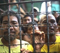 Suspected rebels storm Philippine jail, 158 inmates escape