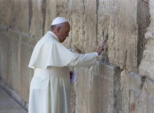 Pope Francis prays in front of the Western Wall, in Jerusalem's Old City, Monday, May 26, 2014. (AP Photo/Oded Balilty)