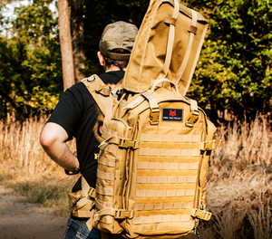 A well designed pack that allows a user to safely transport a rifle or shotgun in the field.