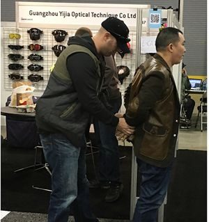 "Above: Jiajun Chen and Ping Zhang, owner and sales manager, respectively, of ""PTide"" (exhibiting as ""Guangzhou Yijia Optical Technique Co. Ltd""), were arrested on the trade show floor at SIA Snow Show in Denver, Colorado."
