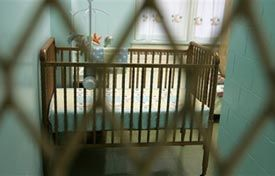 A crib sits in the cell of an inmate housed in the Wee Ones Nursery unit at the Indiana Women's Prison in Indianapolis. (AP photo)