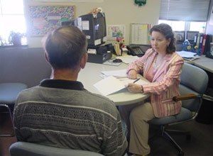 A Probation and Parole Officer with the Missouri Department of Corrections interviews a drug-related offense probationer. (Photo Missouri DOC)
