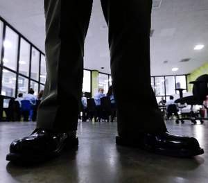 A sheriff's officer monitors inmates during a program at the Twin Towers Correctional Facility Thursday, April 27, 2017, in Los Angeles. (AP Photo/Chris Carlson)