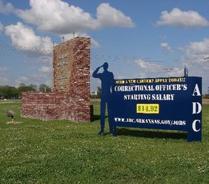 A recruiting sign for the Arkansas Department of Correction greets visitors to the Cummins Unit prison near Varner, Arkansas, which was scheduled to hold executions Thursday, April 20, 2017. (AP Photo/Kelly P. Kissel)