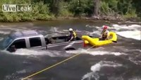 Dog rescued from submerged truck in rapids