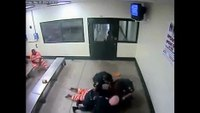 Inmate slams officer to ground, pummels him