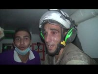 Syran White Helmet rescuer sobs as he rescues infant