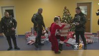 NYPD helps Santa deliver gifts to local kids