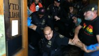 Portland police clash with protesters outside city hall