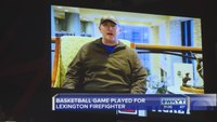 Firefighters play in basketball game for brother with cancer