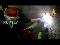 Firefighters rescue dog trapped in rubble