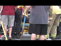 Firefighters rescue woman from overturned SUV