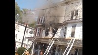 Ladder falls into wires at 3-alarm fire
