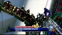 Firefighters rescue dozens stranded on roller coaster