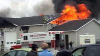 Firefighter stranded on roof at commercial fire