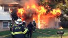 Firefighters struggle to extinguish house fire