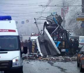 Experts and police officers examine a site of a trolleybus explosion in Volgograd, Russia Monday, Dec. 30. (AP Image)