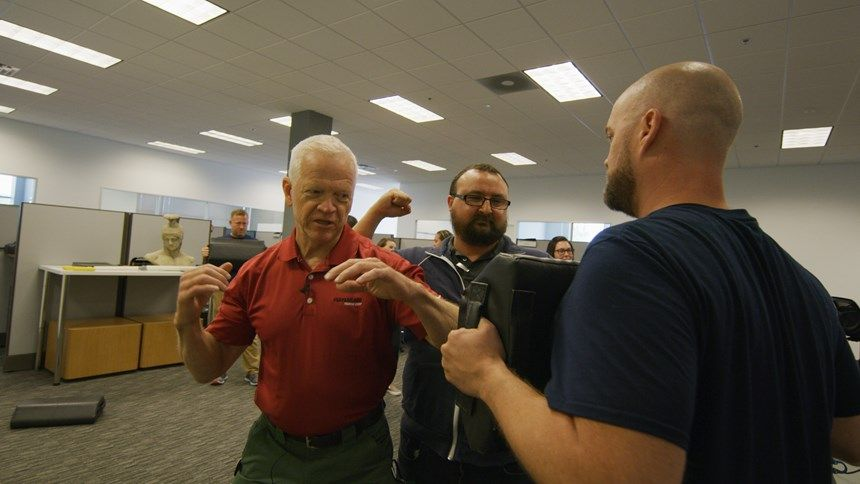 Sandy Wall instructs participants on self defense moves. (Photo/Safariland)